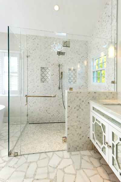 This custom handmade Path mosaic floor is shown in Thassos and Calacatta Tia and was designed by Sara Baldwin for New Ravenna.<br />