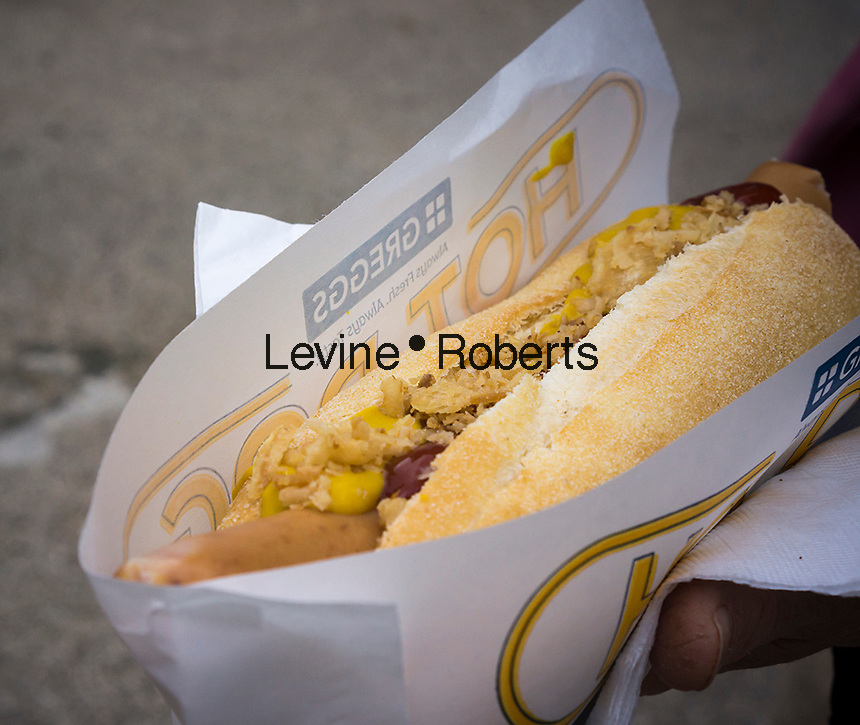 Close up of a hot dog served at the UK bakery chain Greggs' hot dog cart in Madison Square in New York on Tuesday, September 16, 2014, giving away free hot dogs and recording New Yorkers' reactions. The chain is branching out from its sausage rolls and pastries and has introduced coffee and low-fat sandwiches recently. Greggs is the largest bakery chain in the UK with over 1600 outlets. The Madison Square event appeared to have been created solely for the purpose of taping New Yorker's reaction to their hot dogs, perhaps for possible use in a commercial or other advertising. (© Richard B. Levine)