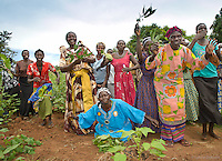 Women leaders at Topeyero Main greet Water To Thrive and Lifeline Fund reps with song ,dance and celebration of the new well they helped to procure for their village, to be drilled by the end of this year in Dec.