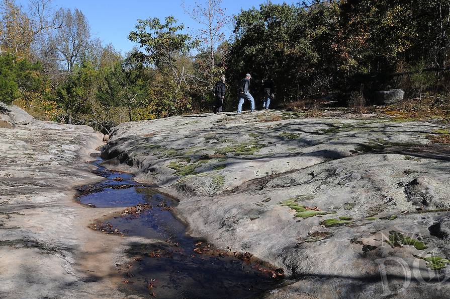 NWA Democrat-Gazette/FLIP PUTTHOFF <br /> Hikers explore along the creek that forms Sweden Creek Falls during a dry October when the waterfall was barely a drip. Northwest Arkansas Master Naturalists do maintenance at Sweden Creek Falls Natural Area and many other sites in Northwest Arkansas.
