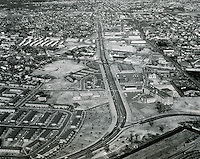 1960 December 02..Redevelopment..Tidewater Drive Area (After)..An aerial view, looking North, of the Southeastern quarter of the City after redevelopment..Tidewater Drive (center) is a mjor north-south traffic artery.  Public housing units are seen to the left of Tidewater Drive, occupying an area formerly infested with residential slums...PHOTO CRAFTSMEN INC..NEG# 45-423.NRHA#..
