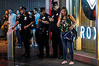 NYPD officer stand guard in Times Square after police increased security during the premier of the movie  'Dark Knight Rises' in New York, July 20, 2012.  Photo by Eduardo Munoz Alvarez / VIEW.