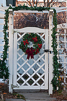 Christmas wreath on a white garden gate