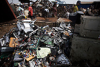 A pile of circuit boards at Agbogbloshie dump, which has become a dumping ground for computers and electronic waste from all over the developed world. Hundreds of tons of e-waste end up here every month. It is broken apart, and those components that can be sold on, are salvaged.