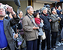 March 18, 2011, Tokyo, Japan - Spectators watch the Tokyo Sky Tree, a telecommunication tower under construction in downtown Tokyo, reach the 634-meter tidemark on Friday, March 18, 2011. The new Tokyo landmark, the world's tallest self-standing structure with two observatories and commercial facilities, is scheduled to begin operating in spring of 2012. (Photo by Natsuki Sakai/AFLO) [3615] -mis-