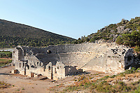Theatre, originally built in the 2nd century BC and restored under Emperor Tiberius, Kursunlutepe Hill, Patara, Antalya, Turkey. The auditorium or koilon seats 6000 in 38 rows of seats, 23 in the upper section and 14 in the lower, and a diazoma contains seats reserved for prominent and privileged spectators. The stage building was built in the 2nd century AD. A removable awning called a velarium provided the spectators with shade from the sun. There are 9 radial stairways and the upper section is also accessible through vaulted corridors ascended by stairs on each side. Above the top row of seats is a temple dedicated to Dionysus. Patara was a maritime Greek and Roman city on the South West Mediterranean coast of Lycia near modern-day Gelemis. It was said to be founded by Patarus, son of Apollo, and was famous for its temple and oracle of Apollo. It was a leading city of the Lycian League. Picture by Manuel Cohen