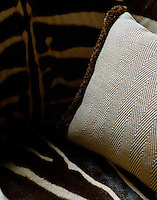 A detail of zebra-skin upholstered seating