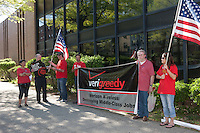 Members of the Communications Workers of America (CWA Local 1103) and MoveOn participate in the Tax the 1% protest at the post office in White Plains, New York, USA on Tuesday, April 17, 2012.  The protest focused on the imbalance of taxation of the middle class vs corporations and the wealthy.
