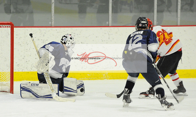 Eagle River goalie Ryan Gray makes a save on a shot by West Valley's Dylan Sauereide as Ian Newman helps out at the MacDonald Center Saturday, November 14, 2016. Photo for the Star by Michael Dinneen