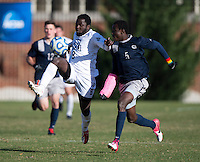 Joshua Yaro (5) of Georgetown fights for the ball with Gideon Asante (8) of Old Dominion during the second round of the NCAA tournament at Shaw Field in Washington, DC. Georgeotown defeated Old Dominion, 3-0.