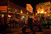 The Knights of Chaos 'Momus Alexander Mortgage' float on Napoleon Avenue at Magazine Street as it rolls through the Uptown area towards St. Charles Avenue in New Orleans, Louisiana, USA.