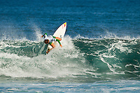 North Shore/Oahu/Hawaii (Tuesday, November 22, 2011) Carissa Moore (HAW).  -- The Reef Hawaiian Pro - the first of the 3-event Vans Triple Crown of Surfing series presented by Rockstar Energy Drink - continued today with the last eight heats of Round two completed and the whole of Round three in 2- to 3-foot surf. A Round of the Clash of the Legends featuring Rob Machado (USA), Ross Williams (HAW), Kalani Robb (HAW) and Shane Dorian (HAW) was also held with Williams taking a win.. Photo: joliphotos.com