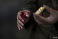 """An actor with fake blood on his hands holds a military epaulette as he prepares for a scene during filming of """"The Last Prince"""" television series at Hengdian World Studios near Hengdian July 23, 2015. Extras and actors with smaller roles often take care of their own costumes and play more than one character in this production about the war against Japan. Director Li Xiaoqiang said the series is about a Qing Dynasty prince, who joined the Chinese nationalist army after suffering family misfortune. """"After he learnt more about the Communist Party, the prince began to understand what real revolution and the anti-Japanese war meant, and turned to the Communist Party to fight Japan"""", the director added. According to local media, more than 10 new movies, 12 TV dramas, 20 documentaries and 183 war-themed stage performances will be released in China to coincide with the 70th anniversary of the end of World War Two. REUTERS/Damir SagoljPICTURE 14 OF 28 FOR WIDER IMAGE STORY """"BEHIND THE SCENES OF A CHINESE WAR DRAMA"""".SEARCH """"SAGOLJ STUDIO"""" FOR ALL PICTURES."""