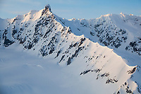 Sunset light on the snow covered mountain peaks of the eastern Alaska Range mountains.