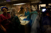 Reflected in a window, nurses sterilize surgical tools while doctors work to reattach a patient's retina on board the ORBIS Flying Eye Hospital on Wednesday, April 15, 2007.   Kevin German /  kevin@kevingerman.com..ORBIS Flying Eye Hospital brought doctors, nurses and specialists from all over the world to Ho Chi Minh City, Vietnam from April 7-18, 2008.  The ORBIS program contributed to the efforts of Ho Chi Minh City Eye Hospital in fighting avoidable blindness by educating local ophthalmologists to diagnose and manage pediatric blindness, retinal disease, oculoplastics, and blindness due to glaucoma..