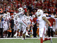 Louisville defensive end B.J Butler intercepts a pass during 79th Sugar Bowl game against Florida at Mercedes-Benz Superdome in New Orleans, Louisiana on January 2nd, 2013.   Louisville Cardinals defeated Florida Gators, 33-23.