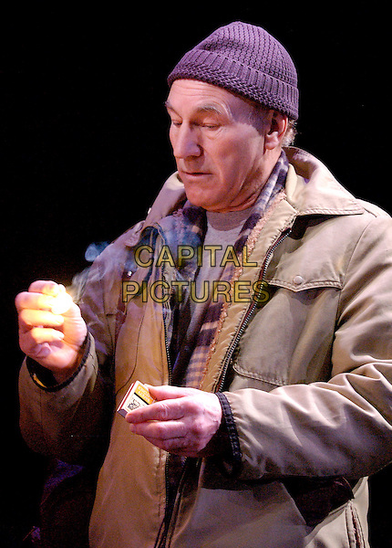 """PATRICK STEWART.Photocall for play """"A Life in Theatre"""", Apollo Theatre, Shaftesbury Avenue, London, 1st February 2005..half length hat on stage costume match fire flame.www.capitalpictures.com.sales@capitalpictures.com.©Capital Pictures."""
