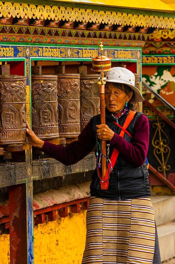 Prayer wheels near the Potala Palace, Lhasa, Tibet (Xizang, China).