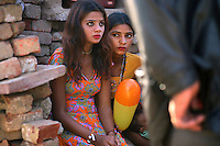 14 year old Nita (left) is from the Bedia caste in the Bharatpur region of Rajasthan. Traditionally the Bedia see their women enter the sex trade from the age of 13-14. Nita is about to enter the profession and the bidding war for her virginity has begun. When the highest bid has been secured the client may visit Nita as much as he likes over the course of 10 days, then with the money paid, the community throws a large party, much like a Wedding Party, to mark her initiation...
