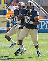 Pitt fullback Jaymar Parrish (31) blocks for wide receiver Tyler Boyd (23) on a wide receiver sweep play. The Akron Zips Defeated the Pitt Panthers 21-10 at Heinz Field, Pittsburgh. Pennsylvania on September 27, 2014.