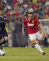 Manchester United FC forward Dimitar Berbatov (9) moves towards loose ball. In a Herbalife World Football Challenge 2011 friendly match, Manchester United FC defeated the New England Revolution, 4-1, at Gillette Stadium on July 13, 2011.