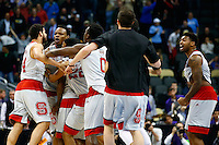 PITTSBURGH, PA - MARCH 19:  Beejay Anya #21 of the North Carolina State Wolfpack celebrates with his teammates after hitting the game winning shot to defeat the LSU Tigers 66 to 65 during the second round of the 2015 NCAA Men's Basketball Tournament at Consol Energy Center on March 19, 2015 in Pittsburgh, Pennsylvania.  (Photo by Jared Wickerham/Getty Images)