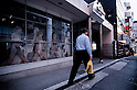 TOKYO - DEC. 9:Pedestrian walks past a Beatles mural on the wall of The Cavernn Club in Roppongi, Tokyo. (Photo by Alfie Goodrich/Nippon News)