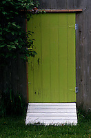 The garden shed has a lime green door