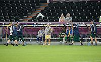 FUSSBALL  EUROPAMEISTERSCHAFT 2012   VORRUNDE Ukraine - Frankreich               15.06.2012 Olexandr Aliyev (Ukraine) steht im Regencape vor der Ersatzbank