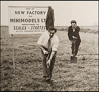 BNPS.co.uk (01202 558833)<br /> Pic: PhilYeomans/BNPS<br /> <br /> Freddie Francis cuts the turf at the original Havant factory.<br /> <br /> Blast from the past - 56 year old box of the very first Scalextric finally handed over to inventors daughters.<br /> <br /> The dying wish of Scalextric inventor Freddie Francis has been granted - after his daughters were gifted an original mint set that has been in storage for the past 50 years.<br /> <br /> Freddie and his widow Diane boxed up the original set shortly before he died in 1998 and Diana has waited till now before handing the valuable heirloom over.<br /> <br /> The previously unopened set has been preserved in a wooden box at the Francis family home until now.<br /> <br /> The historic set contains 1950's Ferrari and Maserati style racing car's that would have been driven by Fangio and Stirling Moss and even includes oil to keep the cars running and silicone for 'skid patches'.<br /> <br /> Although the set cost &pound;5 in 1957, it's worth well over &pound;1500 today.
