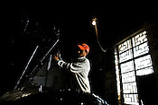 Rajkumar, a factory worker is seen setting the temperature of the drier during the drying process at the Makaibari Tea estate, in Darjeeling, India.