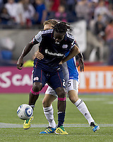 New England Revolution midfielder Shalrie Joseph (21) attempts to control the ball as second half substitute San Jose Earthquakes midfielder Brad Ring (5) pressures. In a Major League Soccer (MLS) match, the San Jose Earthquakes defeated the New England Revolution, 2-1, at Gillette Stadium on October 8, 2011.