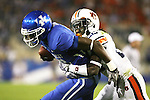 UK wide receiver La'Rod King is tackled by an Auburn defender in the second half at Commonwealth Stadium on Saturday, Oct. 9, 2010. Photo by Scott Hannigan | Staff