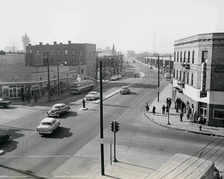 """1956 February 01..Redevelopment.Downtown North (R-8)...Brambleton Avenue (After)..Photograph shows newly widened Brambleton Avenue and surroundind redeveloped area.  Note church spire in both """"before"""" and """"after"""" pictures...PHOTO CRAFTSMEN INC..NEG#.NRHA#.."""
