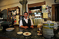 Il Bar Fratelli Nurzia ha riaperto a dicembre 2009..Il Barman Ulisse Di Vincenzo..Dopo il terremoto  del 2009 alcuni negozi e attività commerciali riaprono a L'Aquila..After the earthquake of 2009, some shops and businesses reopen in L'Aquila.