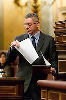 The Minister of Justice, Alberto RuÌz-GallardÛn starts the speech