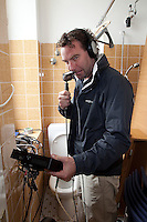 Red Handed TV Executive Producer Sam Usher broadcasting from a toilet in Castle Montfort. Match Race Germany. World Match Racing Tour. Langenargen, Germany. 21 May 2010.