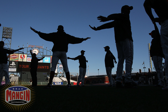 SAN FRANCISCO - October 1:  Members of the San Francisco Giants stretch on the field before the game against the San Diego Padres at AT&amp;T Park on October 1, 2010 in San Francisco, California. (Photo by Brad Mangin)