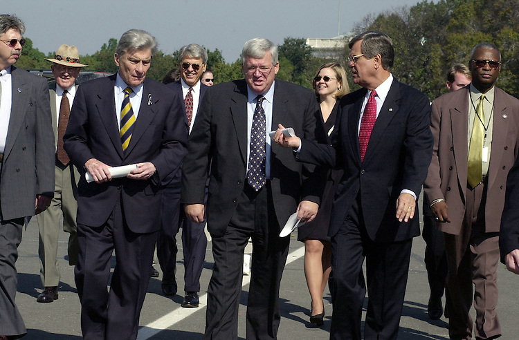 lott4-101900--Sen. John Warner, Rep. Dennis Hastert and Sen. Trent Lott walk to the signing ceremony at the House triangle.