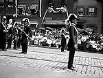 Pittsburgh PA:  Pittsburgh-area Manson marching in the annual St Patrick's Day Parade - 1903.  View of Officer preparing troop to continue march with crowds lining both sides of the street.
