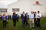 Condoleeza Rice, Cleveland Browns owner Jimmy Haslam, Ohio Senator Rob Portman and Republican vice presidential candidate Rep. Paul Ryan walk onto the Cleveland Browns practice field in Berea, Ohio, October 17, 2012.