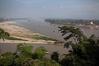 The point of the Golden Triangle where Myanmar, left, Laos, right and Thailand meet on the Mekong River in Sop Ruak, Thailand. The gold-domed Laos immigration center, right, is still under contruction. At far left, the Golden Triangle casino in Myanmar. Photo taken on Thursday, December 10, 2009. Kevin German / Luceo Images