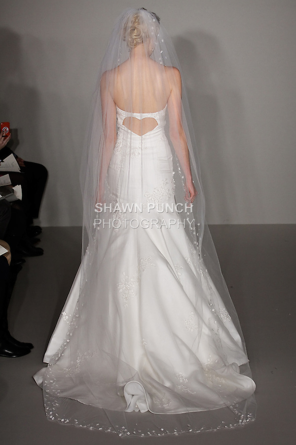 Model walks runway in a Gracie wedding dress - ivory strapless silk organza fit-to-flare embroidered gown with scattered flowered motifs and sweetheart back, by Hayley Paige, for the Hayley Paige Spring 2012 Bridal collection, at the JLM Couture fashion show, during Bridal Week New York Spring 2012.