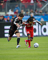 16 April 2011: D.C. United midfielder/forward Chris Pontius #13 and Toronto FC forward Javier Martina #33 in action during an MLS game between D.C. United and the Toronto FC at BMO Field in Toronto, Ontario Canada..D.C. United won 3-0.