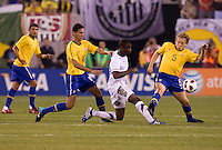 Maurice Edu (19) of the USMNT is defended by Lucas (5) and Paulo Henrique Ganso (10) of Brazil during an international friendly at the New Meadowlands Stadium in East Rutherford, NJ. Brazil defeated the USMNT, 2-0.