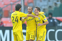 Ben Speas (17) of the Columbus Crew celebrates his score in the 15th minute of the game with teammates Federico Higuain and Agustin Viana. The Columbus Crew defeated D.C. United 2-1 ,at RFK Stadium, Saturday March 23,2013.