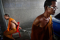 """A Buddhist monk who was detained by Thai army soldiers sits with his hands tied during an operation to evict anti-government """"red shirt"""" protesters from their encampment in Bangkok May 19, 2010. Anti-government protest leaders in Thailand surrendered to police on Wednesday after troops stormed their encampment, sparking clashes that killed at least four people, but violence rocked other areas of the city.   REUTERS/Damir Sagolj   (THAILAND - Tags: POLITICS MILITARY CIVIL UNREST RELIGION)"""