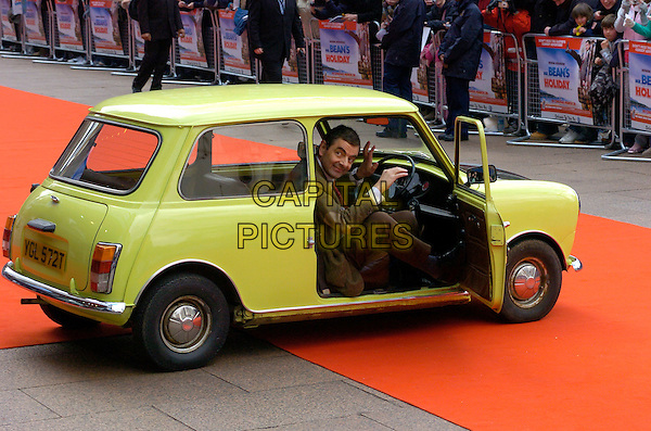 "ROWAN ATKINSON as MR. BEAN.Arrivals at the UK Film Premiere of ""Mr. Bean's Holiday"" at Odeon Leicester Square, London, England, .March 26th 2007. .half length funny in character yellow mini car.CAP/CAN.©Can Nguyen/Capital Pictures"