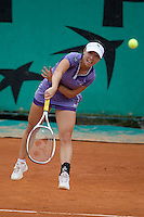 Jie Zheng (CHN) (15) against Michelle Larcher De Brito (POR) in the second round of the Women's Singles. De Brito beat Zheng 6-4 6-3. ..Tennis - French Open - Day 4 - Wed 27th May 2009 - Roland Garros - Paris - France..Frey Images, Barry House, 20-22 Worple Road, London, SW19 4DH.Tel - +44 20 8947 0100.Cell - +44 7843 383 012
