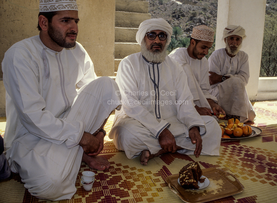 Wadi Bani Kharus, Oman.  Arab Hospitality: coffee, halwa (sweets), and oranges for a guest, the photographer.